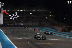 Lewis Hamilton, Mercedes F1 W07 Hybrid, crosses the line and takes the chequered flag to win the rac