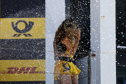 Podium: Grid girl get the champagne shower