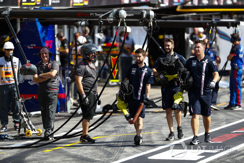 Force India engineers in the pit lane