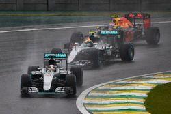 Lewis Hamilton, Mercedes F1 W07 Hybrid, leads Nico Rosberg, Mercedes F1 W07 Hybrid, and Max Verstapp