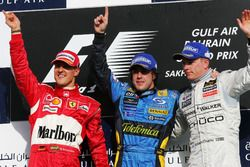Podium: second place Michael Schumacher, Ferrari, Race winner Fernando Alonso, RenaultF1 Team, third place Kimi Raikkonen, McLaren