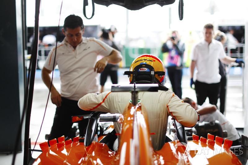 Fernando Alonso, McLaren, enters his cockpit