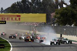 Lewis Hamilton, Mercedes AMG F1 W07 Hybrid locks a wheel under braking into turn one ahead of Max Ve