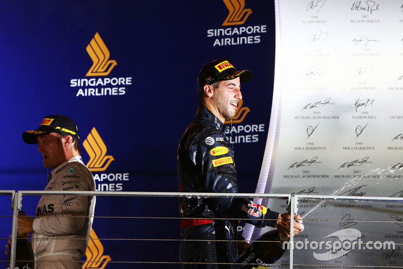 Daniel Ricciardo, Red Bull Racing celebrates his second position on the podium with race winner Nico