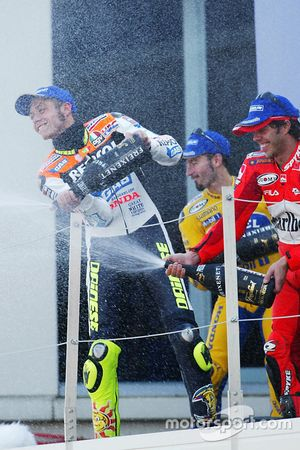 Podium: winner Valentino Rossi, Repsol Honda Team, second place Max Biaggi, Pramac Pons, third place Loris Capirossi, Ducati Team