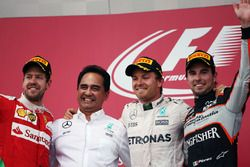 The podium (L to R): Sebastian Vettel, Ferrari, second; Nico Rosberg, Mercedes AMG F1, race winner;