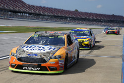 Kevin Harvick, Stewart-Haas Racing Chevrolet, and 20 other cars serve penalties on pit road
