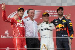 Second place Sebastian Vettel, Ferrari, Race winner Third place Valtteri Bottas, Mercedes AMG F1 Da
