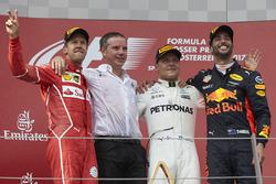 Second place Sebastian Vettel, Ferrari, Race winner Third place Valtteri Bottas, Mercedes AMG F1 Dan