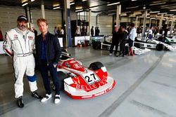 Nico Rosberg, stands in front of a 1977 March 761, raced in period by Patrick Neve