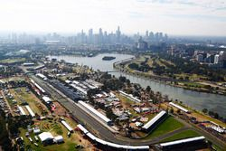 An aerial view of the grid at Albert Park and the Melbourne skyline