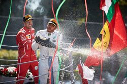 Race winner Third place Lewis Hamilton, Mercedes AMG F1 Sebastian Vettel, Ferrari, pour Champagne from the podium