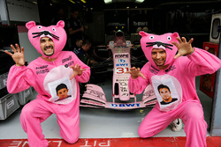 Fans of Force India, dressed as Pink Panthers, in the Force India garage