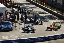 Sébastien Buemi, Renault e.Dams, and Daniel Abt, ABT Schaeffler Audi Sport, leave the pits