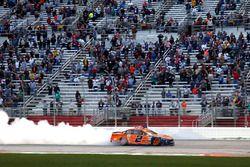 Brad Keselowski, Team Penske Ford, celebrates after winning