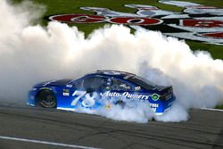 Martin Truex Jr., Furniture Row Racing Toyota celebrates his win with a burnout
