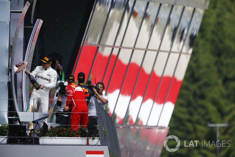 Winner Valtteri Bottas, Mercedes AMG F1, sprays champagne on the podium, Sebastian Vettel, Ferrari, Daniel Ricciardo, Red Bull Racing