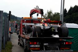 The car of Max Verstappen, Red Bull Racing RB13 is recovered by marshals after stopping on track