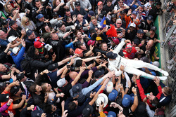 Race winner Lewis Hamilton, Mercedes AMG F1 goes crowd surfing