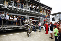 A robot performs outside the Red Bull Energy Station