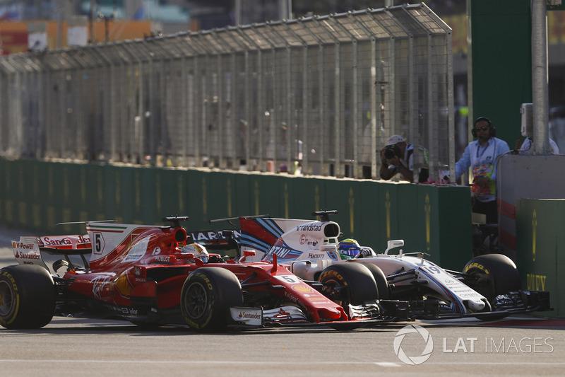 Sebastian Vettel, Ferrari SF70H, battles, Felipe Massa, Williams FW40, at the restart