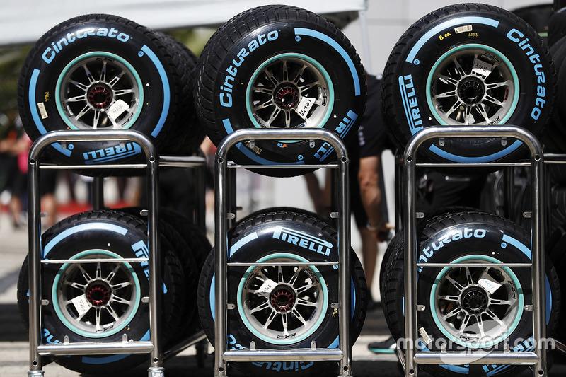 Trolleys of Pirelli tyres in the paddock