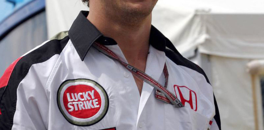 Button gives up title hopes