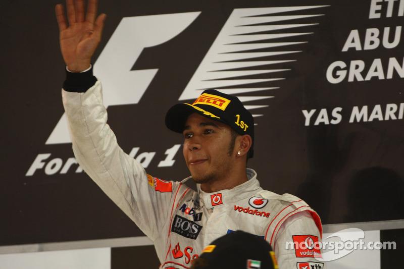 Happy Hamilton wins but Button second in 2011 title