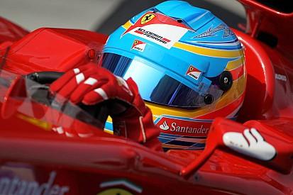Alonso F1's shock leader at soggy Sepang
