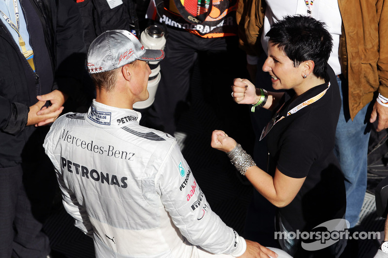 Schumacher hints intention to race in 2013