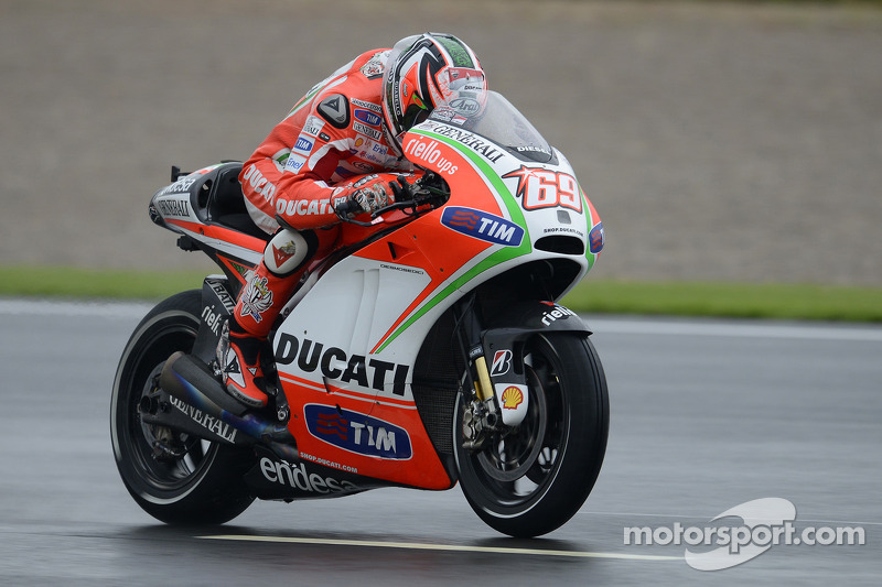 Third and fifth best times for Hayden and Rossi on wet Valencia track