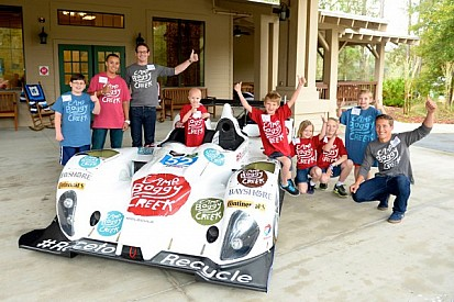 Montecalvo and Jeannette fly the flag for Camp Boggy Creek - video