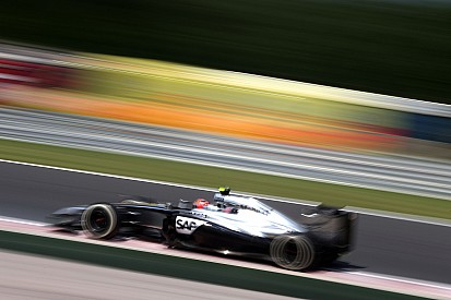 Button will start from the clean side of the grid on tomorrow's Hungarian GP