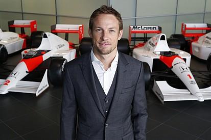 Button optimistic as McLaren retains him for 2015