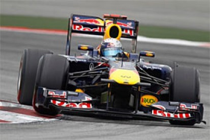 Vettel eases to Malaysian GP victory