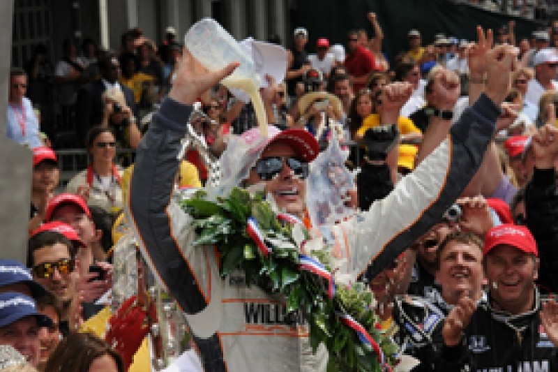 Wheldon takes dramatic Indy win