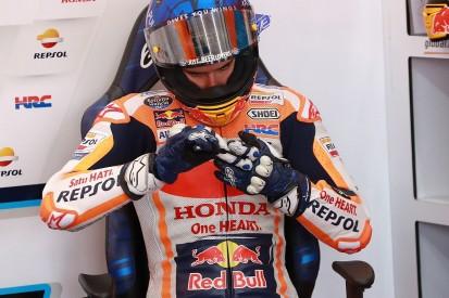 Marquez escapes with hand injury after violent Valencia MotoGP crash