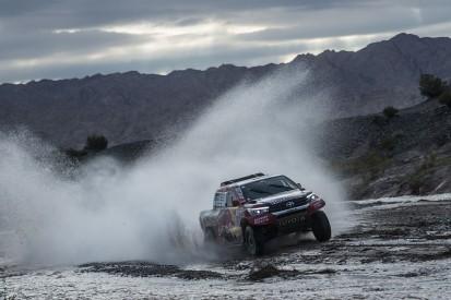 Toyota's Al-Attiyah tops longest test as Sainz edges to Dakar win