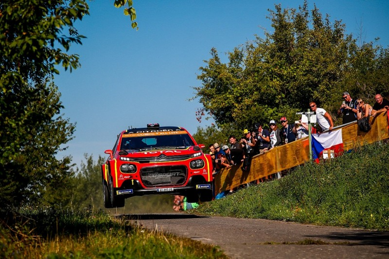 Ostberg near miss with spectator who fell off wall on Rally Germany