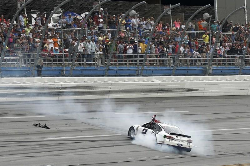 Brad Keselowski hangs on for victory in chaotic Talladega race