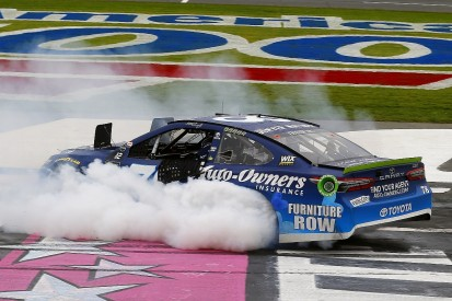 NASCAR Charlotte: Martin Truex Jr wins in overtime, into last eight