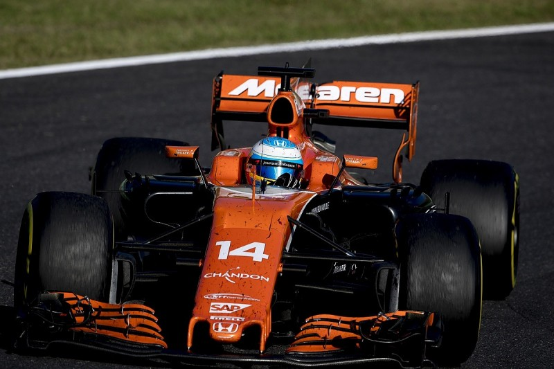 Alonso warned for slowing Hamilton up in Japanese GP lead battle