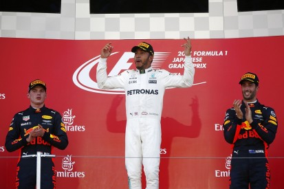 Hamilton wins the Japanese GP to close on F1 title, Vettel retires