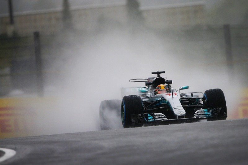 Japanese GP practice: Lewis Hamilton fastest but session a washout