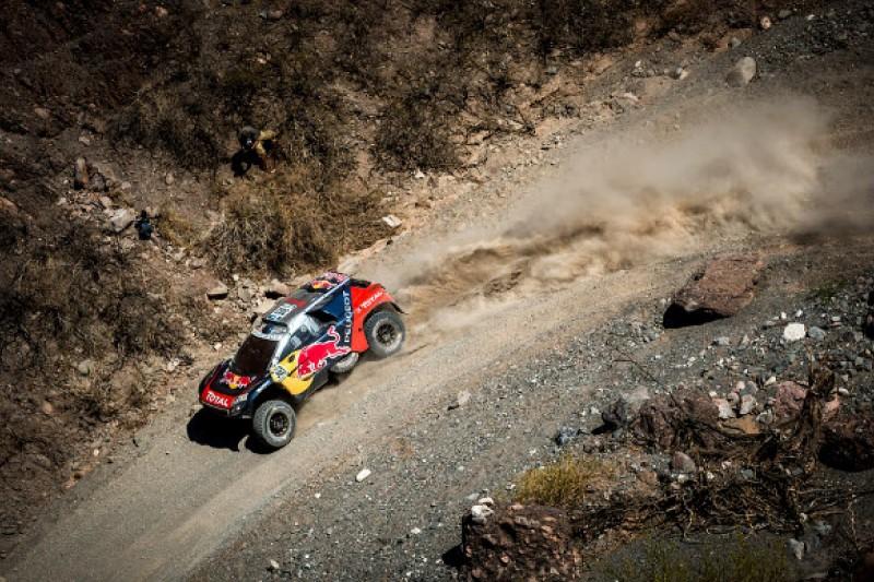Carlos Sainz into Dakar Rally lead after winning shortened stage