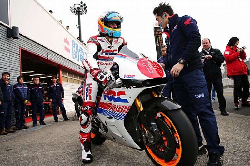 McLaren F1 driver Fernando Alonso tries Honda MotoGP bike at Motegi