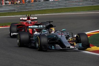Belgian Grand Prix: Hamilton resists F1 title rival Vettel for win