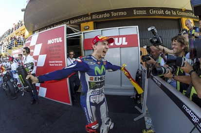 Valencia MotoGP: Lorenzo beats Marquez to win and Rossi to title