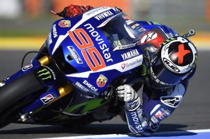 Valencia MotoGP: Jorge Lorenzo on pole as Valentino Rossi crashes