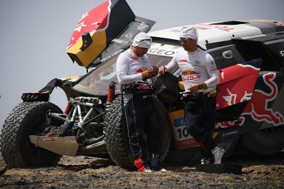 Sebastien Loeb crashes from the lead on new Dakar Peugeot's debut